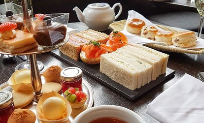 image for Cream Afternoon Tea for Two or Four at Joshua Bradley (Up to 20% Off)