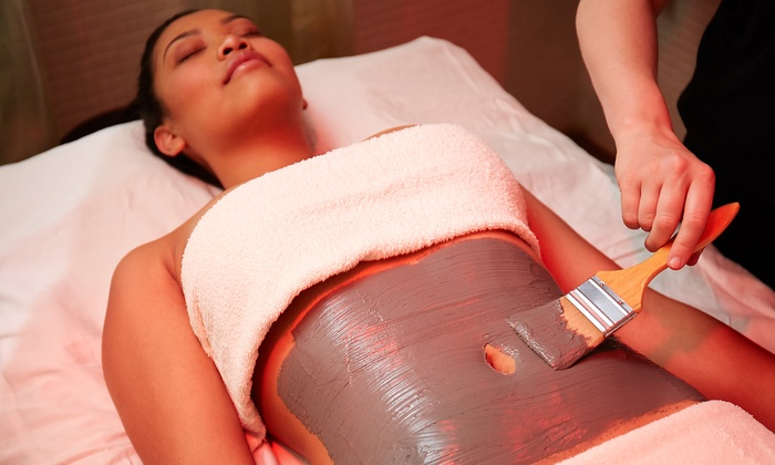 Revive Day Spa - Downtown Fullerton: One or Three Detox or Slimming Wraps with Body Scrubs at Revive Day Spa (Up to 62% Off)