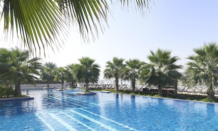 Pool and Beach Access for Up to Four and AED 100 to Spend per Adult at Poolside at Fairmont Bab al Bahr (Up to 51% Off)
