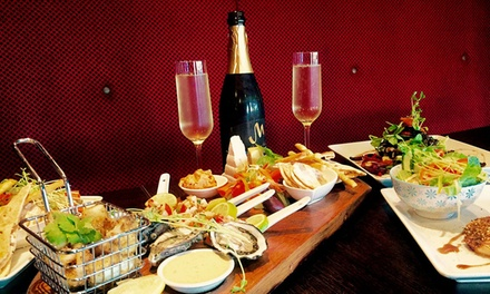 TwoCourse Meal with Beer/Wine/Cider for Two $49 or Four People $97 at The Artel Lounge and Bar Up to $222 Value