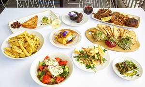 ENA Greek Street Food: Seven-Course Greek Feast with Wine for Two ($59) or Four People ($115) at ENA Greek Street Food (Up to $272 Value)