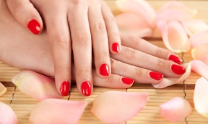 Nailz 27: Manicure + Towel Massage ($29) + Optional Scrub ($39), or Pedicure + Foot Massage ($45) at Nailz 27 (Up to $100 Value)