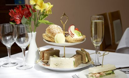 image for Afternoon Tea with Prosecco for Two or Four at The George Hotel Colchester (45% Off)