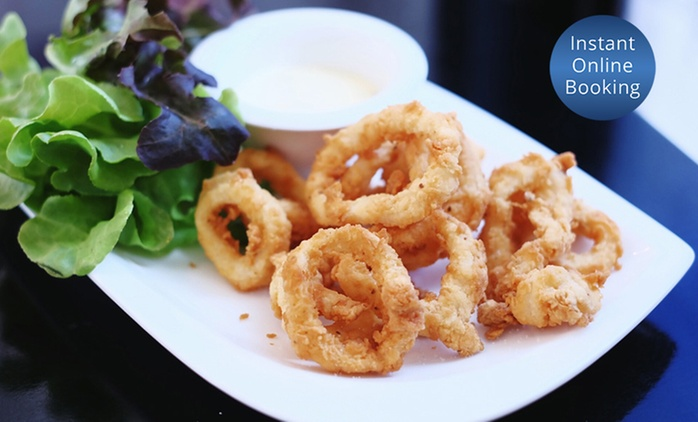 $16 for a Cocktail and Salt and Pepper Squid or $49 for Four Cocktails and Two Platters at Peg Leg (Up to $124 Value)