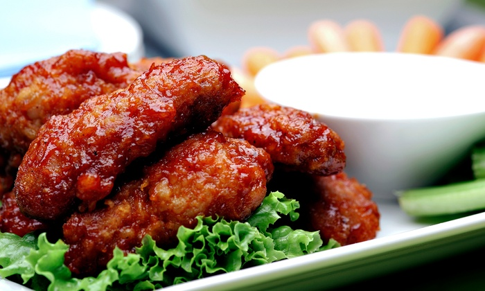 Wild Over Wings - Garland: Dine-In or Take-Out Wings at Wild Over Wings (Up to 40% Off). Three Options Available.