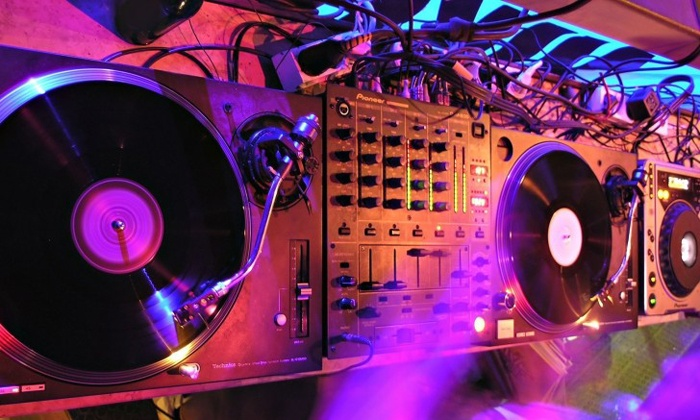 Spin and Mix Your Own Beats like a Master DJ - Seattle: Learn the ins and outs of setting up gear, using equipment, and making your own mixes alongside top DJ Kristina Childs.