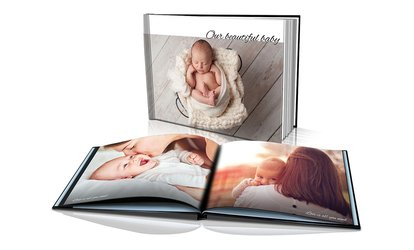 22-Page Softcover Photobook ($1.99) or 100-Page Hardcover Photobook ($39) from Dinkleboo (Up to $174.99 Value)