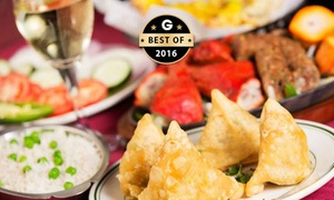 Indilicious: Three-Course Indian Feast with Sides and Wine for Two ($29) or Four People ($55) at Indilicious (Up to $183.80 Value)