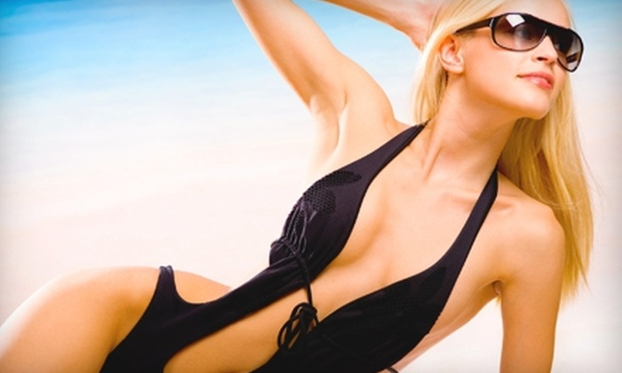 Tropical Tan - Multiple Locations: UV- and Spray-Tan Package, Five Red-Light-Therapy Sessions, or Five Mystic Spray Tans at Tropical Tan (Up to 74% Off)