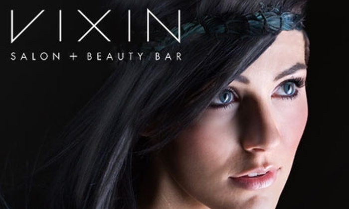 Vixin Salon & Beauty Bar - Downtown Winnipeg: $80 for a Haircut and Colour Treatment (Up to $187 Value) or $40 for a Haircut and Redken Treatment ($87 Value) at Vixin Salon & Beauty Bar