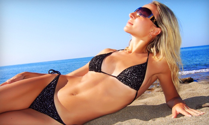Envy Tan - Corryville: One Month of UV Tanning, One Month of Red Light Therapy, or Three Spray Tans at Envy Tan (Up to 66% Off)