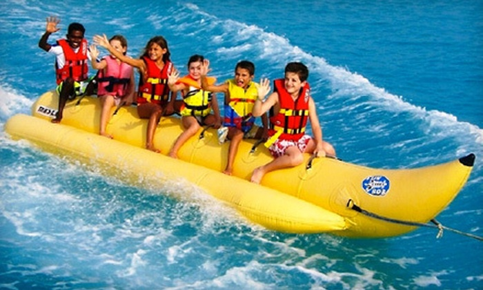 Makin Waves - Clearwater: Umbrella and Chair Rental or Banana-Boat Ride at Makin Waves in Clearwater Beach (Half Off)