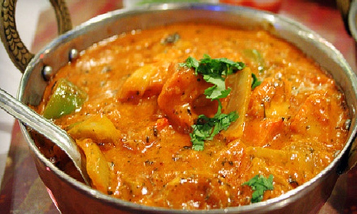 Cafe Taj - McLean: $27 for a Three-Course Indian Meal with Appetizer and Dessert for Two at Cafe Taj in McLean (Up to $55.83 Value)