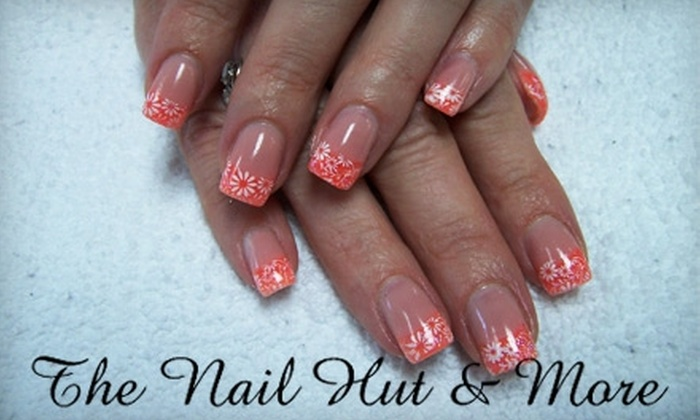 The Nail Hut & More - Reno: $30 for Full Set of Acrylic or Gel Nails ($65 value) or $50 for a Cut, Single Process Color, and Style ($100 Value) at The Nail Hut & More