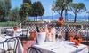 LA CONCHIGLIA (SIRMIONE) - LA CONCHIGLIA (SIRMIONE): Menu di 4 portate con specialità di pesce e bottiglia di vino sul lago di Garda da La Conchiglia (sconto fino a 65%)