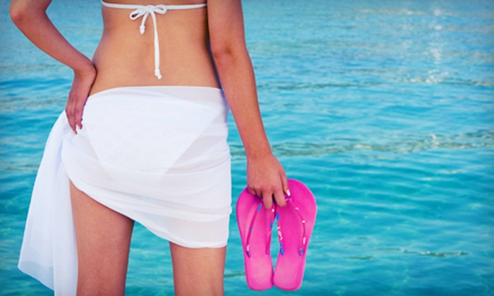Total Tan - Multiple Locations: One, Three, or Five Infrared Weight-Loss Body Wraps at Total Tan (Up to 79% Off)