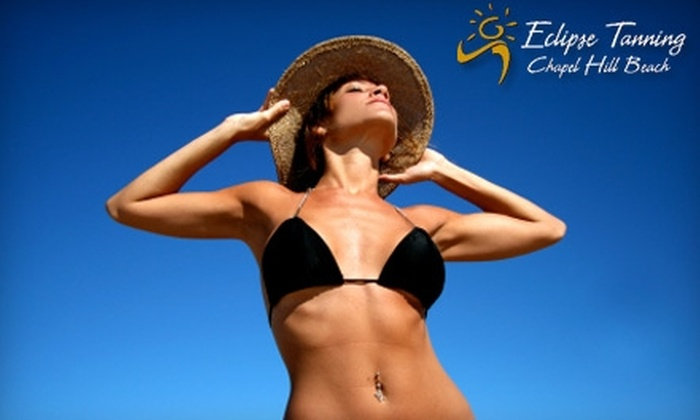 Eclipse Tanning Salon - Raleigh / Durham: $35 for One Month of Unlimited Tanning ($69.99 Value) or $15 for One Spray Tan ($29.99 Value) at Eclipse Tanning Salon