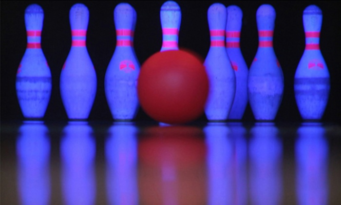 Super Bowl - Highland Acres: Galactic-Bowling Outing with Shoes for 12 or Bowling Outing with Shoes and Pizza for 6 at Super Bowl (Up to 67% Off)
