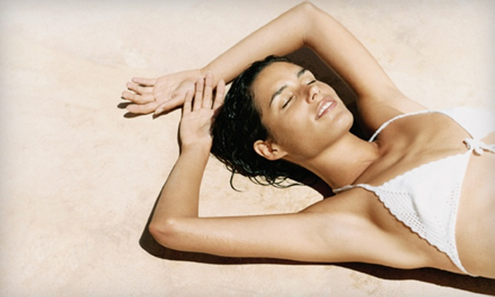 Kahiki Tan - Evansville: 5 or 10 Tanning-Bed Sessions or 2 UV-Free Airbrush Tans at Kahiki Tan (Up to 56% Off)