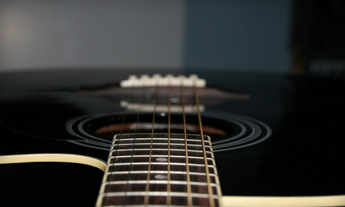 Give to Live Guitar Studios - Multiple Locations: $50 for One Month of Private Guitar Lessons at Give To Live Guitar Studios ($100 Value)