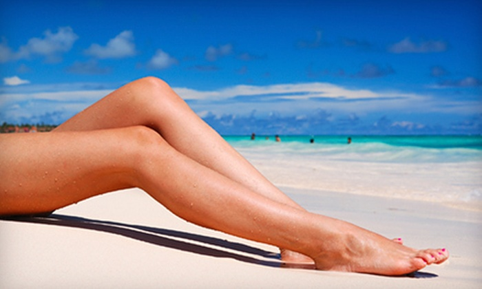NY Sun Club - Multiple Locations: One or Three Mystic Spray Tans or Tanning-Bed Sessions, or One Organic Airbrush Tan at NY Sun Club (Up to 67% Off)