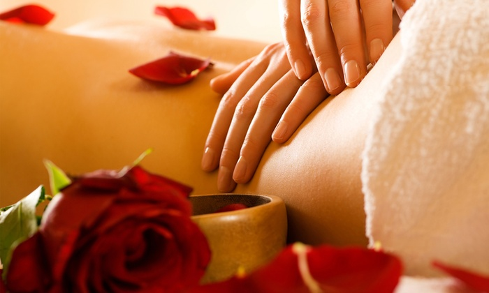 Salon 517 - Neptune Beach: One or Three Therapeutic Massages with Aromatherapy and Hot Towel from Regan Cagle at Salon 517 (53% Off)