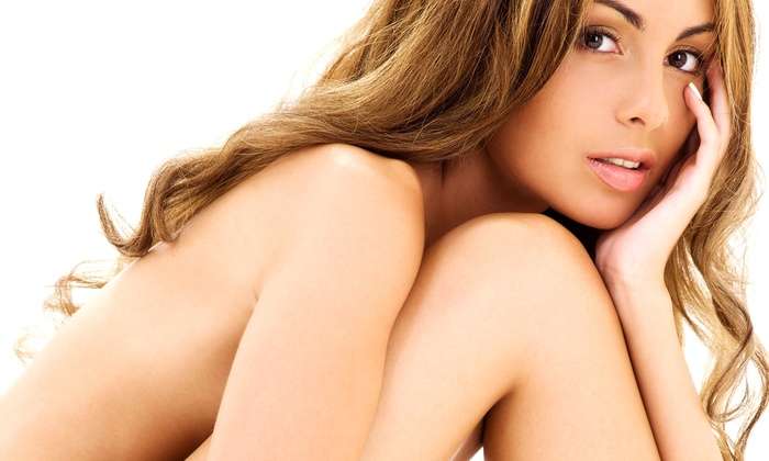 Down Under Tanning - Livermore: Five UV-Tanning Sessions or One or Three Airbrush Tans at Down Under Tanning (Up to 57% Off)