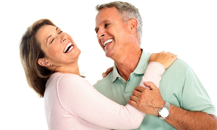 Chicago Smile Center - Multiple Locations: $4,899 for Two Dental Implants with Abutments, Crowns, X-rays, and Cleanings at Chicago Smile Center ($8,400 Value)
