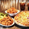 Up to 56% Off Pizza & Casual Fare at Tumblers Bar & Grill