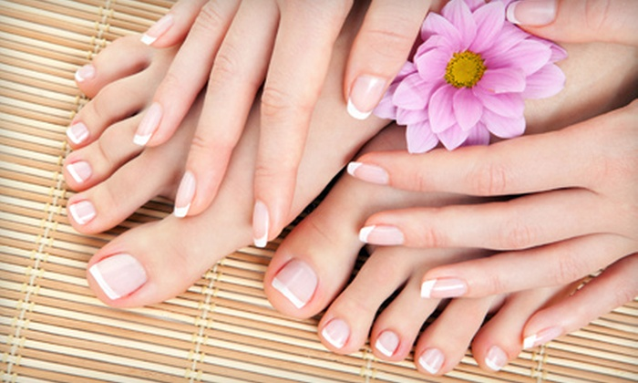 Attractions Hair & Nail Salon - Loves Park: Spa Mani-Pedi or Two Shellac Manicures at Attractions Hair & Nail Salon (Up to 51% Off)