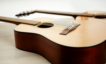 image for Two or Four Half- or One-Hour Guitar <strong>Lessons</strong> at RockStar Guitar (Up to 60% Off)