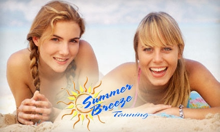Summer Breeze Tanning - Multiple Locations: $25 for 45 Days of Unlimited Tanning ($64.50 Value) or Two Mystic Sunless Tanning Sessions (Up to $50 Value) at Summer Breeze Tanning