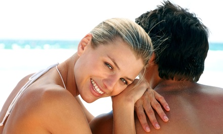 Three Full-Body Spray Tans, Custom Airbrush Tans, or UV Tans, or Month of UV Tanning at SunWerks (Up to 61% Off)