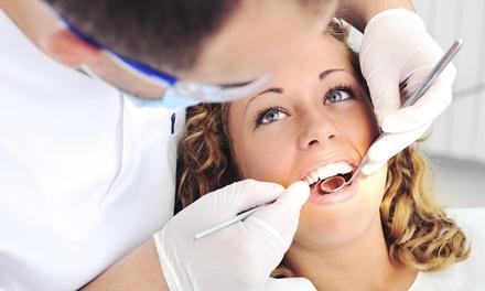 Limpieza bucal con 1 o 2 sesiones de blanqueamiento LED con opción a férula dental Michigan desde 12,90€ en Clinic White