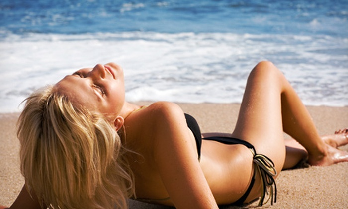 Solar Energy Tan - Madison: Five Red Light Therapy Sessions, Five Mega-Level UV Tans or Three or Five Spray Tans at Solar Energy Tan (Up to 68% Off)