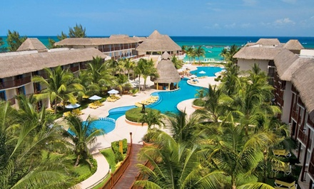 Groupon Deal: 4-, 5-, or 7-Night All-Inclusive Stay for Two at The Reef Coco Beach in Playa del Carmen. Includes Taxes and Fees.