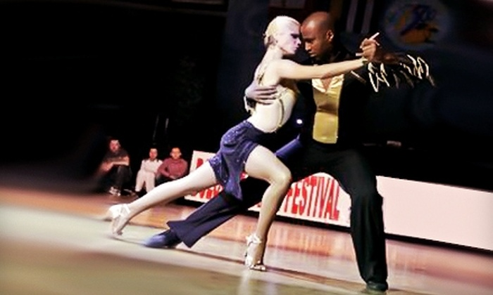 Salsa International - Garment District: Four Weeks of Unlimited Classes at Salsa International. Two Options Available.