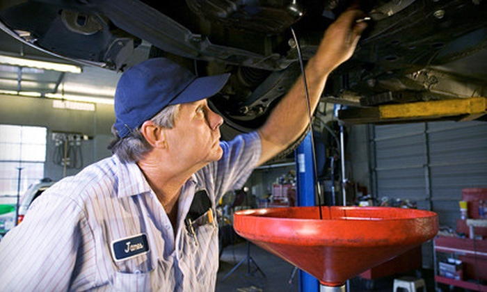 Dick Masheter Ford's Quick Lane - Columbus: One or Three The Works Oil-Change Packages at Dick Masheter Ford's Quick Lane (52% Off)