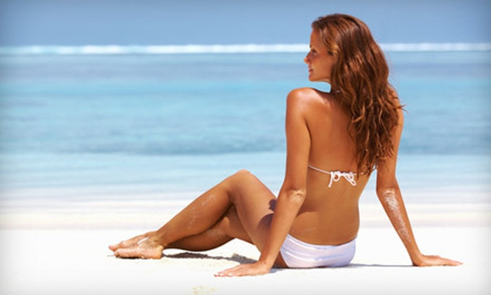 Salon Bronze - Multiple Locations: 10 or 20 UV Tans in a Level 2 Bed or 3 or 5 Spray Tans at Salon Bronze (Up to 75% Off)