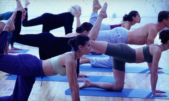 Bikram Yoga Carle Place - Carle Place: 5 or 10 Bikram and Vinyasa Yoga Classes at Bikram Yoga Carle Place (Up to 58% Off)