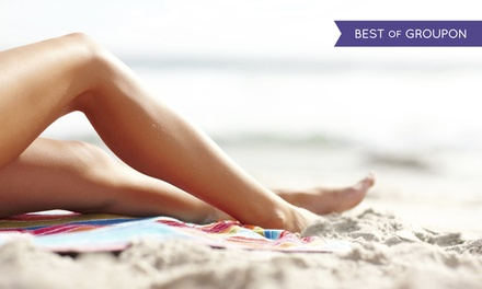 UV or Spray Tans or Three Months of Unlimited Red-Light Treatments at Ultimate Exposure Tanning Centers (85% Off)