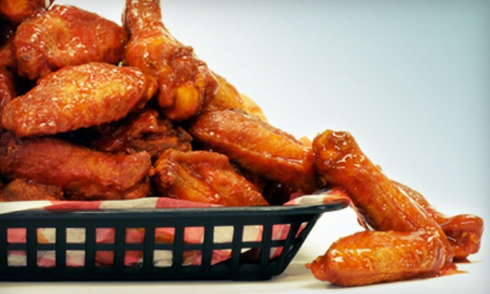 Wing Champion - Madison Avenue: Wings, Fries, and Drinks for Two or Four at Wing Champion in Council Bluffs (55% Off)