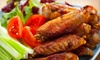 District 7 - Malden Center: $15 for $30 Worth of Pub Dinner Food at District 7