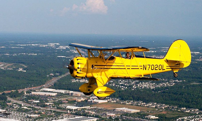Biplane Rides Over Atlanta - 57th Fighter Group Restaurant: $89 for an Open-Air Biplane Ride from Biplane Rides Over Atlanta ($175 Value)