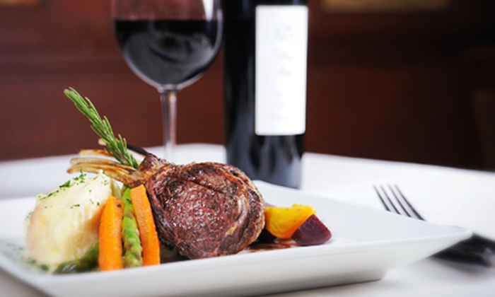 The Broker Restaurant - Denver: $75 for a Four-Course Prix Fixe Steakhouse Dinner for Two with Bottle of Wine at The Broker Restaurant ($150 Value)