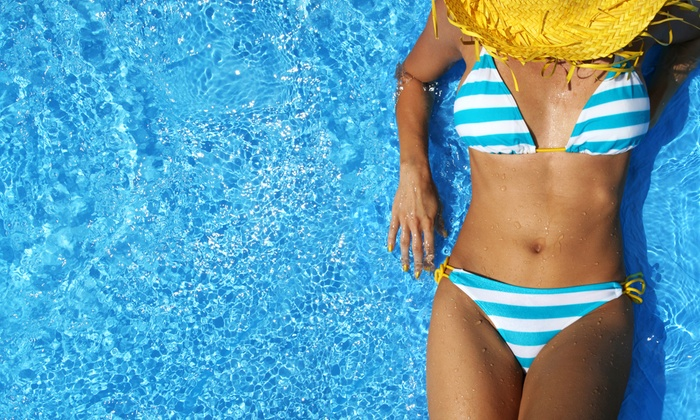 ProTan Spa - Multiple Locations: Three of Five VersaSpa Spray Tans with Level-2 Bed Tanning or Infrared Body Wraps at ProTan Spa (Up to 77% Off)