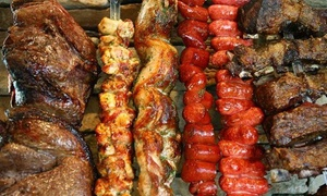 Midwest Grill: Brazilian Barbecue Dinner for Two or Four Adults at Midwest Grill (54% Off). Two Locations Available.