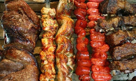 Brazilian Barbecue Dinner for Two or Four Adults at Midwest Grill (47% Off). Two Locations Available.