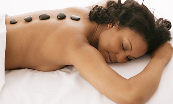 Massage 49 - Addison/Carrollton: Spa Package for One or Two with Massage, Facial, Foot Scrub, and Hot-Towel Treatment at Massage 49 (Up to 54% Off)
