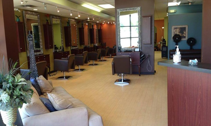 Q Salon & Spa - Rochester: Women's Haircut with Conditioning Treatment from Q Salon & Spa (55% Off)